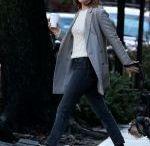 DAKOTA JOHNSON Walks Her Dog Out in New York