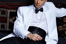 White Tuxedos / White tuxedos can be worn to a variety of formal events including weddings, proms, cruises, dinners, galas and list goes on and on! Matching white pants can be worn with some styles, but many gentleman opt to go with the contrasting black pants to accompany the white jacket. Subtle variations include full black satin lapels, black trim lapels and also subtle black accents on the pockets. Although some photos may appear a little darker than others, all tuxedos are a pure white.