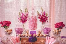 Plum+ Gold Floral Baby Shower Dessert Table / This gorgeous Plum + Gold Floral Baby Shower was the decadent style of the Dessert Table. Dressed in Rose gold sequin linen and rose gold sequin backdrop with lush deep magenta florals, gold mercury tealights and gold mirror trays. Our Graphics team created floral water colour patterns for the chocolate wraps, and dessert table accents. Plum+ Gold Floral Baby Shower Dessert Table. Youtube: https://www.youtube.com/watch?v=dIOCzUlngH8&feature=youtu.be