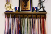 2 Foot Medal Awards Rack & Trophy Shelf / MedalAwardsRack.com    -Ships in 1-3 Business Days! -19 pegs to accommodate lanyard ribbon medals -Dual Groove shelf design to accommodate up to 9 pin style cased medals -Top shelf for the placement of trophies, plaques or other accolades -100% Satisfaction Guaranteed  -US Patent Pending  Display Shelf, Medal Awards Rack, Trophy Shelf, Sport Awards, Running Medals, Display the hardware you have worked so hard to earn!
