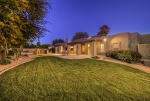 11750 N 108th Place Scottsdale, AZ 85250 /    Custom home  w/ 4 bedrooms & 3 bathrooms this split floor plan is enveloped in light & comfort. Sophisticated w/ travertine tile, vaulted ceilings & exposed beams, & crown molding. Master Suite w/ his & hers walk-in closets, a private restroom & office/den. Gourmet kitchen boasts granite counter tops, a breakfast nook & bar, dual ovens, a skylight, and recessed lighting. The backyard oasis, pebble sheen pool, outdoor kitchen, flagstone, large grassy area & multi-patios