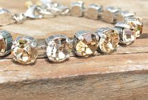 Classy Crystals / These are snappy shots of our own products! Sometimes we get tired of white backgrounds, and want to see our jewelry in the wild!