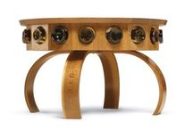 Don Vino Wine Table /  The Don Vino wine table is a Chicone Cabinetmakers original design, inspired by the oak barrels that line the cellars of regional wineries. It not only offers contemporary styling but also a tasteful showcase for your wine collection.