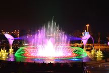 Multimedia Fountain Shows / The GHESA multimedia shows base their choreography on making the  water  dance  to  the  rhythm  of  melodies,  including  high  impact  effects such as lasers, projections on water screens, special lighting, 3-D video mapping, fireworks, etc., to display large scenarios of light and colour based on the cybernetic fountain.