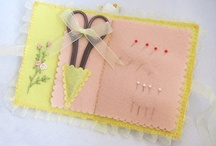 Pin cushions, needle holders and aprons