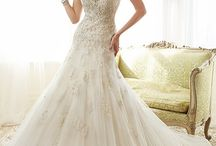 Sophia Tolli / Bridal Dresses by Sophia Tolli are classic as well as soft and romantic. A perfect wedding gown fit, wedding dress silhouettes include; A-line, strapless, halter and trumpet. The draping and corset backs add drama to every gown by Sophia. Trudys Brides in Campbell, Sophia Tolli options include detachable belt, train and sleeves. Many of her signature dress feature draping and corset backs to provide an elegant look with an impeccable fit for any shape or size bride. Sophia's signature wedding dresses are designed with classic style and elegance featuring strapless ball gowns, A-line dresses, halters and fitted gowns.