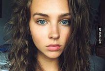 blue eyes, dark hair