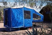 Motorcycle Deluxe Camper / Motorcycle camper trailer. Best trailer made all off the ground. Features, queen bed, dinner table, storage under bed and large storage area when closed.