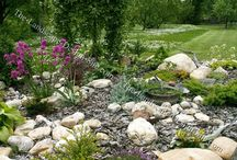 Backyard Escapes / Landscaping, paths, water features, fire pits, benches, rocks, flower gardens, planting areas, retaining walls, and other ways to turn backyards into special places to get away and relax.