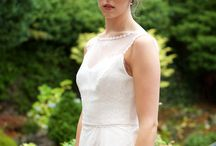 Charlotte / Charlotte is an Ivory lace over man-made crepe dress. Fitted in to the waist with simple guipure lace detail. The skirt has a soft A line shape. Photographer: Jenni Browne Photography