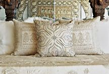 Beautiful combination of carved architectural salvage and rough white linens.
