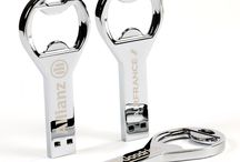 Metal USB Memory Sticks / Collection of Metal USB Memory Sticks that are printed or engraved with a company logo.