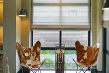 Wns Architecten   Meer mooiste kanten / In het Westlands tuindersgebied worden de woningen steeds meer geclusterd tot woonerven in een groene omgeving met veel water. Ook bij Lisette en Gerard is glas geruild voor een Frank Lloyd Wright-achtig woonhuis met een ruime tuin plus tuinhuis. De bewoners zijn vol lof over WnS architecten.