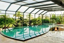 Screen Enclosures / A screened enclosure keeps insects and debris out of your pool, making swimming or simply relaxing poolside more pleasant. Choose a style that blends with your house, and your pool area becomes an extension of your home. Our customers can select a bronze or white frame and a dome or mansard roof.