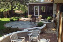 Kildare Avenue - Skokie, IL / Complete backyard/patio transformation.  Addition of new screened in porch, replacement of old bluestone and concrete patios with new bluestone and clay paver patios, plantings and sod.  Installation of Unilock Olde Quarry retaining walls and steps.