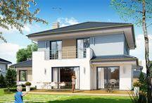 Projekt domu Szmaragd 5 / Projekt domu jednorodzinnego piętrowego, z garażem częściowo wbudowanym w bryłę. Przeznaczony dla 4-5cioosobowej rodziny. Dom ma nowoczesną, ale nie agresywną architekturę. Bryła budynku jest zwarta, przykryta kopertowym dachem.