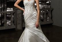 MGNY Madeline Gardner / MGNY Madeline Gardner of New York wedding dresses and bridal gowns are elegant, beautiful and will make you shine on your special day. MGNY wedding dresses are created with big city sophistication from the finest material and manufactured with the greatest attention to detail.