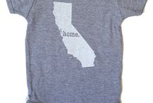 """The Home T Baby Onesies / The Home T baby onesie is the perfect way for an infant to show off the state they call home. And for what it's worth, they are absolutely adorable!  As with all of our products, it's 100% made in the USA and a portion of profits is donated to multiple sclerosis research.   Oh, and by the way, it's guaranteed to prompt plenty of """"aww, how cute!"""" responses."""