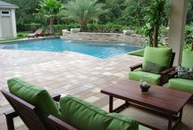 Backyard Paradise Design / Backyards are suppose to be relaxing and a place to have fun. That's exactly what this backyard in Jacksonville, FL promotes. 5 Star Outdoor Design custom built this pool with the beautiful water bowl features. They also built the outdoor paver areas in such a way that there are multiple spots to choose from when you want to kick back and relax.