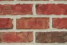 Dartmouth   Triangle Brick Company / Give your building project an Ivy League look with Triangle Brick Company's Dartmouth brick, This historic special production tumbled brick features a softly-textured, classic red base with sienna, burnt umber, and charcoal accents. Offered under our Premium tier, the Dartmouth brick delivers the perfect combination of traditional and modern sensibility for projects of all types. Our Cape Cod brick is a great alternative if you are looking for a more streamlined look.