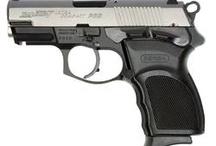 Target shooting and guns / Guns & Targets  / by Andrea Schartz