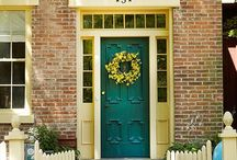 Red brick and green front doors