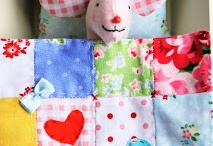 Ailee's Baby Clothes Quilt  / by Cassie Aegerter