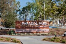 Parasol Park / Surrounding the Orange County Great Park in Irvine, California are a series of neighborhoods, each with a different personality than the next. RSM Design has been working closely with FivePoint Communities to help bring these neighborhood and park spaces to life through environmental graphics. The Parasol Park development focuses on a higher density of housing, and features a large community park, garden, greenhouse, and community building.