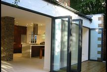 Bi Folding or Folding Sliding Doors / Bi-fold doors allow the maximum use of space and glide along aluminium top and bottom tracks using stainless steel rollers - making opening and closing effortless.