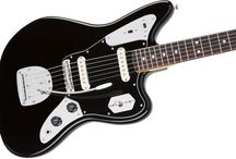 """GAK Fender Jaguars / The Fender Jaguar is an electric guitar by Fender Musical Instruments characterized by an offset-waist body, a relatively unusual switching system with two separate circuits for lead and rhythm, and a medium-scale 24"""" neck. Owing some roots to the Jazzmaster, it was introduced in 1962 as Fender's feature-laden top-of-the-line model, designed to lure players from Gibson."""