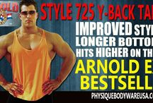 2015 Arnold Fitness Expo Y-Back Stringer Tank Tops / New & Improved Style and Fit. Longer length with thinner straps! Available in 5 sizes: S-XXL. Up-to 5 inches longer than our classic style 725A stringer tanks. Our original Men's Y-back stringer tank tops are guaranteed to be the best fitting tank top you've ever owned! Buy Men's Y back stringer tanks for only $12.98 each when you buy 3 or more! Our exclusive, V-tapered scooped bottom stringer tank tops are custom made for bodybuilders for over 3 decades.