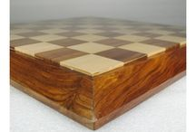 Sheesham Wood Chess Boards - chessbazaar.com / These chess boards are made from the shesham wood. Shesham is inexpensive and easily crafted by the craftsmen but still it provide excellent chess pieces and chess boards. Shesham a light brown or golden color wood is best with boards. It is also the most popular wood than another type of wood. You can buy these chess boards at affordable prices. The underside of the board is filled with green velvet.