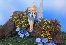 Featured Fairy Gardens / Take a stroll through our featured fairy gardens at Enchanted Gardens. Enchanted miniature fairy gardens full of fairy houses, fairy doors and enchanted miniature fairy garden supplies.