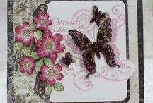 Butterfly Medley Collection / The Butterfly Medley Collection of stamps, dies, and papers is bursting with botanical roses and butterflies in soft shades of pastel peach, lilac, sage, lemon, teal and pink. Six hand drawn stamp sets featuring botanical roses and butterflies can be paired with two sets of dies, allowing you to stamp and die cut a host of embellishments with a single pass through your die cutting machine.