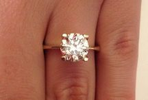 Diamond and gold solitaire ring