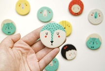 painted brooches