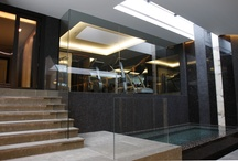 Project: St Johns Wood / An underground excavation and build with Minimal Windows, IQ Heated Glass and internal glass elements surrounding a swimming pool