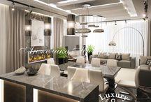 Дизайн квартиры в ЖК Андреевский в стиле модерн / Интерьер квартиры в «ЖК Андреевский» выполнен в стиле модерн. Светлые стены и белая мебель подчёркивают дизайн комнаты, и она выглядят более просторной и светлой. Большие окна позволяют наполнить помещение солнечным светом. Квартира не перегружена мелкими деталями, а темный декор интерьера делает дизайн стильным.