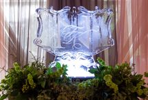 Event: Royal Purple Wedding / This lovely couple wanted a sentimental and elegant ceremony and reception for their wedding day designed with table numbers representing the couple's favorite places and a monogrammed ice sculpture!