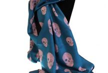 UNISEX SKULLS SCARVES / That's right! Unisex Rich Kid Skulls Scarves are just cool. These huge size wholesale skull scarves are premium quality and that perfect finishing touch for any outfit. As you see they fit our models pretty well even on their motorbike.  These delicate warm fashion scarves are individually packed and come in choice of five rich and bold colours.