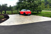 Custom Concrete Driveways / Add some character to your entrance with a custom concrete driveway; we can support the design and implementation to meet your needs.