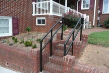Railing / Treated wood deck on girders with white vinyl railing.  http://kennedyhomeimprovement.biz/DecksandRailing.html