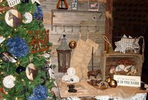 """Burlap, Blue Jean & Bling"" / Deck the stalls!  Honorable and heirloom homage to the horse and barn life. Rustic metal steeds, latigo rope and denim tinted baubles and florals put a western gallop on the Tannenbaum.  Large natural stars and lacey ball-shaped ornaments add a splash of snow to the equine theme and make the saucer shaped horse portraits, metal and box signs even more memorable. Add burlap and leather boots to the tableau at the base, and a touch of barn dance backdrop with a marquee lit mount. / by Iron Accents"
