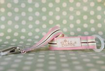 Babbu Dummy Clips / Babbu is a small business based in the East of Pretoria owned by Desiré Nel. We design and create a range of unique baby products made with the finest collection of ribbons and 100 % cotton. I pride myself that each product is hand made with love, care and attention to detail.