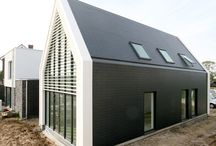 House Bemelen / Contemporary house in a quiet town in Limburg, The Netherlands. The house is finished in slates and plastering, and has a large vide overlooking the countryside.