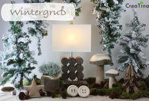 Wintergruss / Unser Thema Wintergruß bestehend aus einer Stehlampe, Holzpilzen, Sternen, einem Treibholzbaum, Holzknöpfen und einer Holzschale. Machen Sie es sich daheim gemütlich mit warmen Tönen.