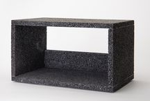 Organizers :: Lava Shelves /  Just as lava flows and morphs into different shapes, these shelves can be transformed in multiple ways when arranged in a room. A bookshelf or a credenza, an altar or a nook for a special collection: these are all possible by setting them on a table, hanging them from a wall or stacking them. Carefully handcrafted from volcanic rock, these shelves are the latest addition to the Lava collection, which breathes new life into the untamed nature of the rock through sophisticated everyday objects.