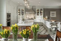 Embassy Row / Beautifully detailed craftsmanship and abundant storage unite in this traditional space. Soft gray cabinets provide a warm alternative to white, and a contrasting center island accommodates multi-person food prep. Entertaining is made easy with two dishwashers, multiple sinks, a butler's pantry and gift wrap station.