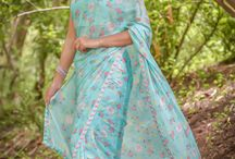 Mermaid's Dream Pure Silk-Chiffon Printed Saree with Raw-Silk Ribbon Embroidered Blouse / PRICE INR 14,455/-; US$ 219.00 To buy click here https://www.eastandgrace.com/products/mermaids-dream-saree Featuring the Mermaid's Dream mint-colored floral print pure silk-chiffon saree. The mint, blended raw silk blouse is embellished with pink ribbonwork roses on the edges. It comes with an unstitched blended raw-silk blouse piece with pink rosebuds and an unstitched matching lycra-satin petticoat fabric. Reach us: care@eastandgrace.com