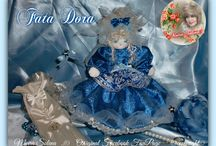 FATA DORA / Fatina scintillante,   FATA DORA. Bella, azzurra e scintillante, cucita a mano su stoffa laminata con bordura in tulle e stelline applicate singolarmente...PROFUMATA CON DELICATE ESSENZE.